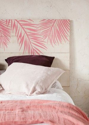 You can decorate a bed headboard by painting it