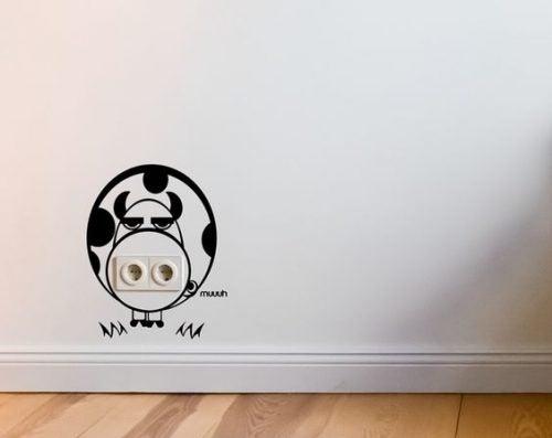 Hide power outlets with decorative vinyls