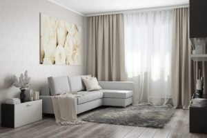 If your living room curtains are comprised of two layers of fabric, you can cross them for a romantic look.