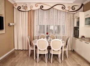 Lace or embroidered kitchen curtains will add a touch of sophistication and charm.