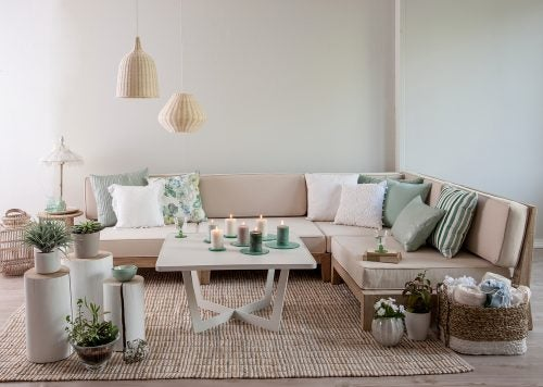 Use horizontal furniture and many points of light for a spacious living room