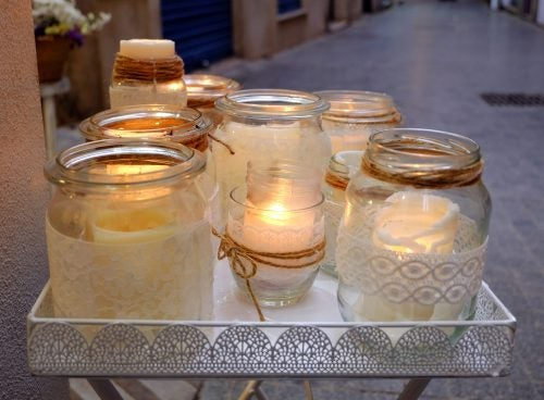 Use decorated glass jars as candle holders