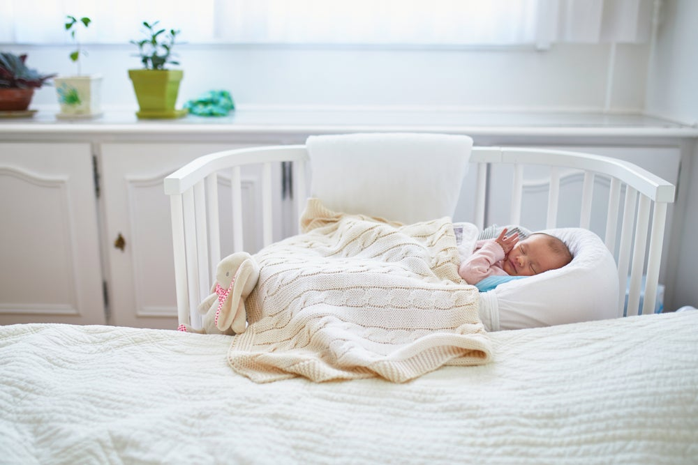 You'll need to be practical when creating room for the baby in your bedroom.