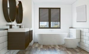 A bathroom with a combination of wood and the color white.