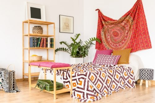 You could hang a printed fabric with mandalas behind the bedhead