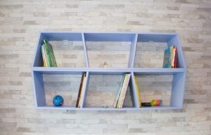 If you don't have much space, a small floating bookcase is a great option.