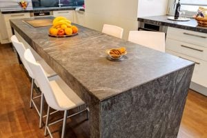 Duetto granite countertops are rust-colored and great for industrial style kitchens.