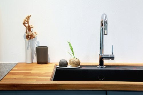 Faucet attached to a black sink