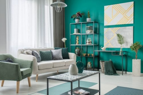 You should include some bright color such as turquoise and some natural items such as plants to balance out a decor including gold and silver