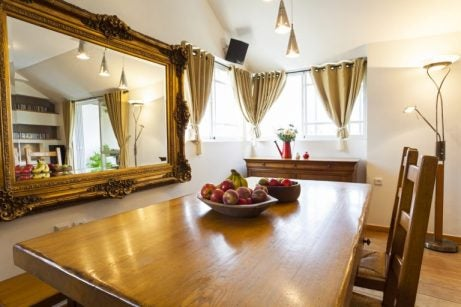 Hang your dining room mirrors on the wall next to your table to get the perfect look.