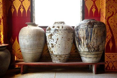 Three large jars on a very low platform