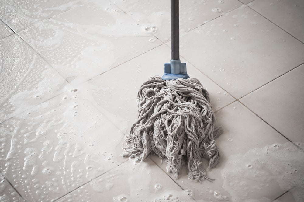 Cleaning kitchen stains can be tackled with a mop and bleach.