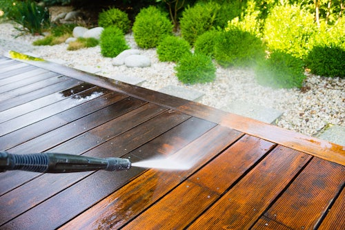 Cleaning off all the winter grime is important for getting the perfect deck.