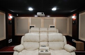 You can buy cinema-style chairs for your home movie theater.