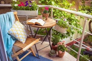Create charming spaces on your balcony or terrace by adding a table, chair and decorations.