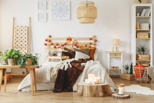 A rustic style bedroom can be bettered by including tables made using tree trunks to add a nice original touch