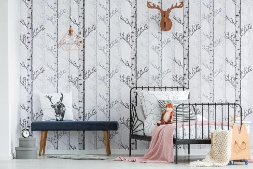 You can use wall paper in neutral and silver tones to decorate a bedroom with style