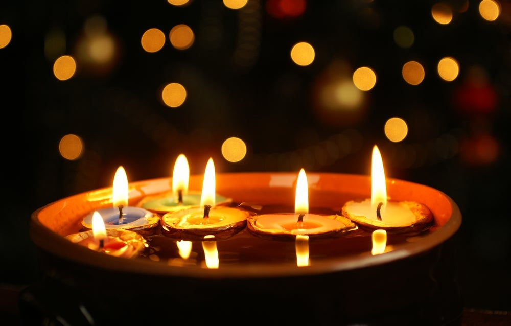 Putting candles in water is another way to present decorative candles.