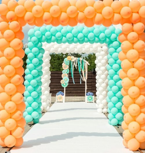 Balloon arch in orange, white and turquoise.