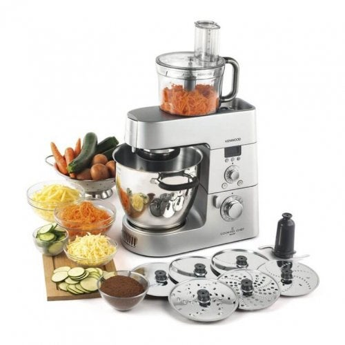 Kitchen robot made of stainless steel with chopped up veggies