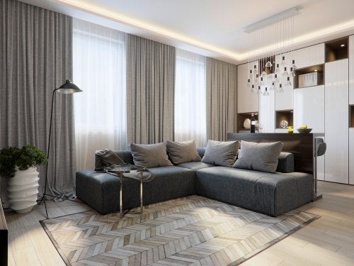 When decorating with rugs, use a large rug to mark out the sofa area