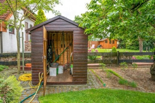 Brown garden shed used as a toolshed