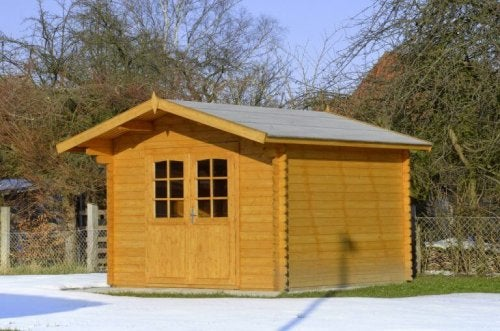 Little garden shed made into a log hut.
