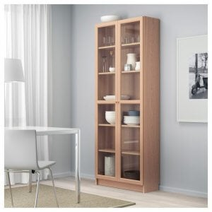 Wood and glass shelves with doors will ensure the contents are safe from harm.