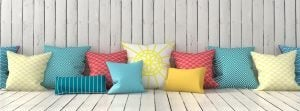 By lots of different sizes of cushions to create a more dynamic look.