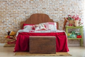 wooden chest at the foot of a bed