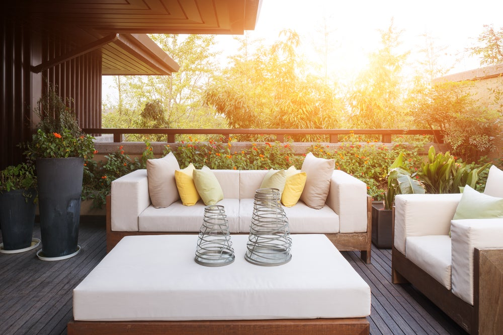 Wood can be a good material for outdoor sofas.