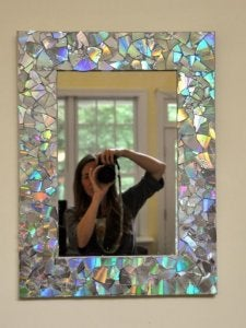 use CDs to decorate the mirrors in your house