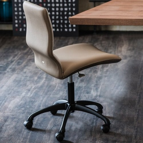 Choose an office chair not just for its design but for comfort and stability