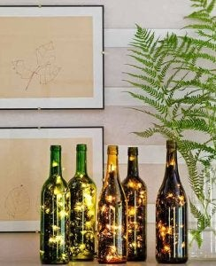 DIY lamp with string lights in a glass bottle