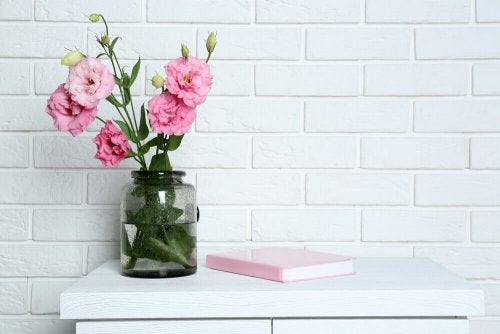 Using flower vases is a great way to decorate shelves with jars