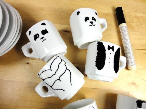 mugs with a panda drawn on by marker
