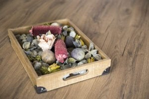 Display your river stones and pebbles in a box to create a really charming decoration.