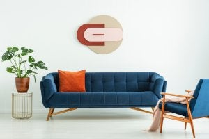 blue couch with copper-colored cushion