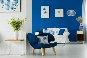 ultramarine chair, wall, pillows, and wall art