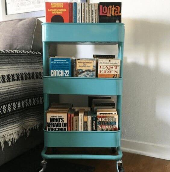 IKEA blue metal cart with stacked books