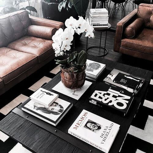 Pile a few stylish books with the same color scheme on the coffee table
