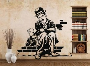 A decal sticker shows Charlie Chaplin as the tramp, sitting beside a dog on a brick stoop.