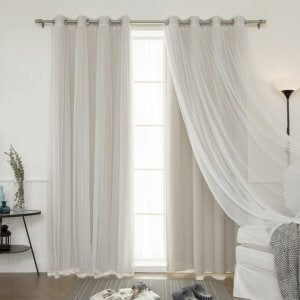 Thin curtains in a white, light living room.