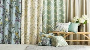 A series of elegant curtains in different styles and patterns on display.