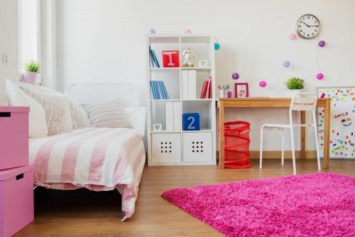 A pink long pile rug in a bedroom