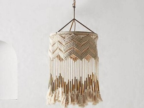 A hanging lamp shade done in cream wool