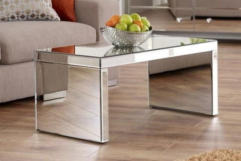A coffee table with mirrors on all sides.