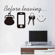 "A decal that says ""before leaving"" with pictures of a phone, keys, purse, and smile."