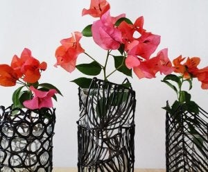 A picture showing a couple small plants in unusual containers.