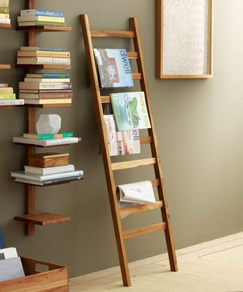 Cute timber vertical bookshelf with a timber ladder with books